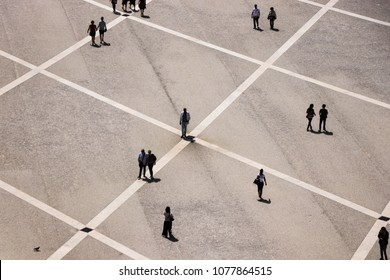 Aerial view of a group of people walking in a square in the city of Lisbon in Portugal. April 2018