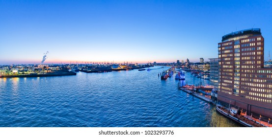 Aerial view of Hamburg Harbor, Germany, at dusk. The Port of Hamburg (Hamburger Hafen) is a sea port on the river Elbe. It is Germany's largest port and the second-busiest port in Europe.