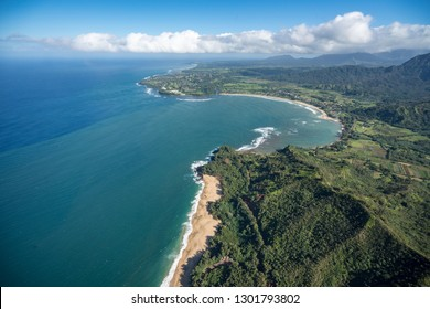 Aerial view of Hanalei Bay and Lumaha'i beach on hawaiian island of Kauai from helicopter flight