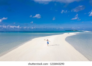Aerial view of happy girl with sandbank