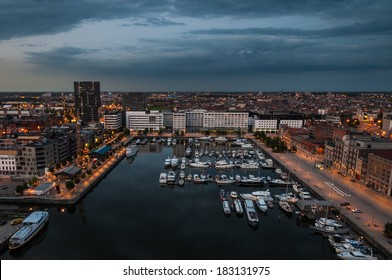 Aerial view to the harbor of Antwerp from the roof of MAS Museum in evening, Belgium.