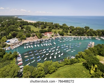 Aerial view of a harbor with boats looking north along the shoreline of Lake Michigan.