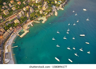Aerial view of the harbor city of Santa Margherita Ligure, Italy. Yachts, boats, ships in the parking lot in the bay of the resort town. Early in the morning