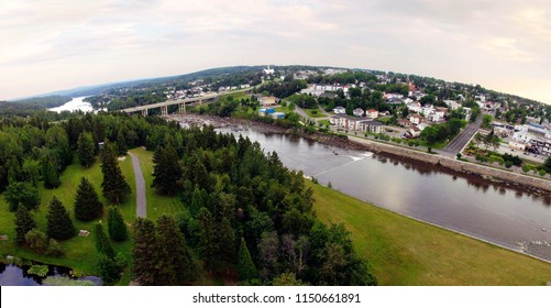 Aerial view of harnessed river flowing through town, Alma, Quebec, Canada, panorama fisheye effect