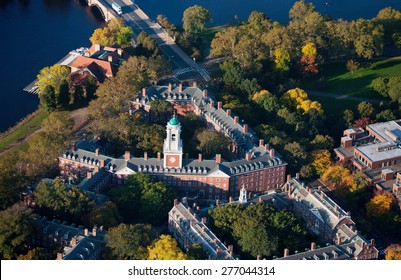 AERIAL VIEW of Harvard Campus featuring Eliot House Clock Tower along Charles River, Cambridge, Boston, MA