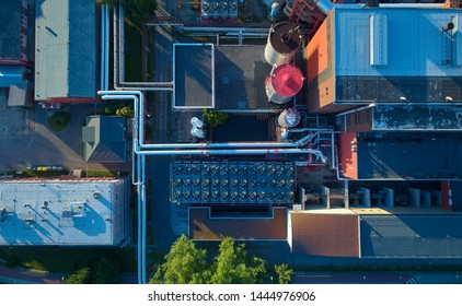 Aerial view of heating plant and its equipment, pipes and coolers. Vertical view. High energy facility providing heat to the big city.