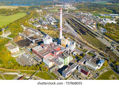 Aerial view of heating plant and thermal power station near railway. Combined modern power plant for city district heating and electrical power production. Industrial zone from above.