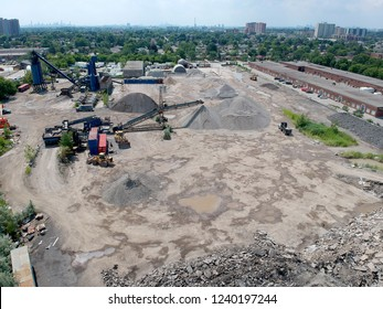 Aerial view of heavy machinery for  crushing and collecting stone, limestone, sand and gravel, materials for asphalt producers and paving road, construction. Road asphalt plants recycle and storage.