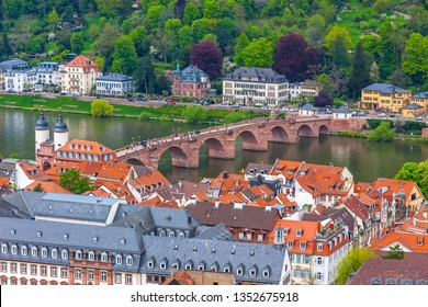 Aerial view of Heidelberg city, Baden-Wurttemberg state, Germany. Old town (Altstadt) and Old Karl Theodor bridge (Alte Brucke) over Neckar river on a background. View from Heidelberg Castle