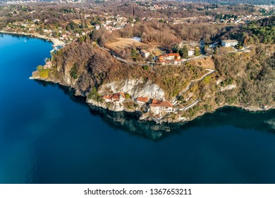 Aerial view of Hermitage of Santa Caterina del Sasso, clinging to a rock face directly overhanging the lake Maggiore, Leggiuno, Italy