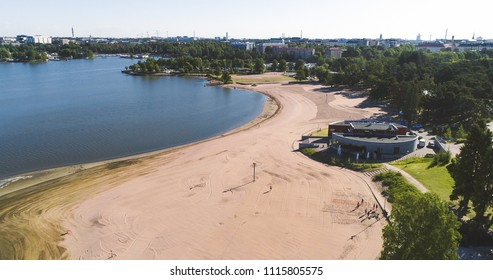 Aerial view of Hietaniemi beach, in the city of Helsinki, on a sunny summer morning, in Helsingfors, Uusimaa, Finland