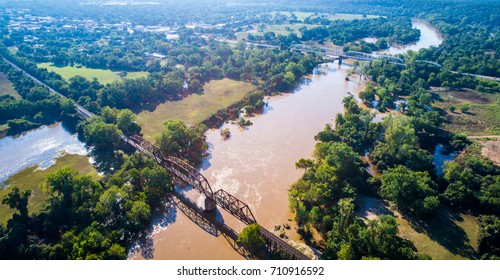Aerial view high above Colorado river flooded record level flooding in La Grange as small town declares disaster zone from hurricane Harvey massive flooding and destroyed communities