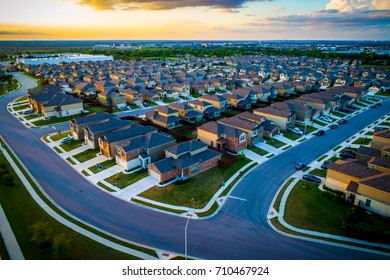 Aerial View high Above Suburbs Austin Homes on the Market buy and sell and the Real Estate industry is booming in the Central Texas Capital City suburbia Sunset