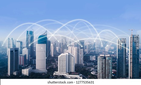 Aerial view of high buildings with network connection at morning time in Jakarta city