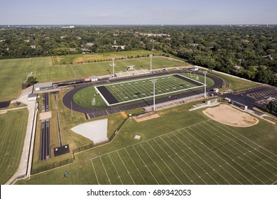 Aerial view of a high school football field and track in a suburban setting in Northbrook, IL