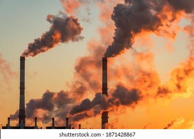 Aerial view of high smoke stack with smoke emission. Plant pipes pollute atmosphere. Industrial factory pollution, smokestack exhaust gases. Industry zone, thick smoke plumes. Climate change, ecology - Shutterstock ID 1871428867