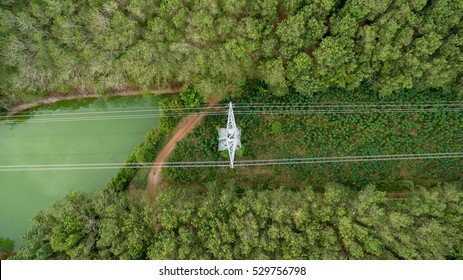 Aerial view of High voltage post or High voltage tower in forest