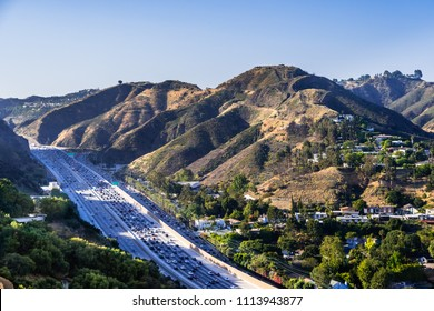 Aerial view of highway 405 with heavy traffic; the hills of Bel Air neighborhood in the background; Los Angeles, California