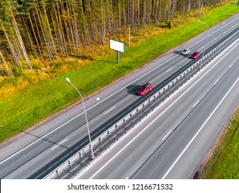 Aerial view of highway. Cars crossing interchange overpass. Highway interchange with traffic. Aerial bird's eye  highway. Expressway. Road junctions. Car passing. Top view from above. Cars in motion