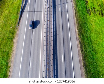 Aerial view of highway in city. Cars crossing interchange overpass. Highway interchange with traffic. Aerial photo highway. Expressway. Road junctions. Car passing. Top view from above. Cars in motion