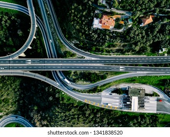 Aerial view of highway, expressway and motorway with a toll payment point in rural Italy
