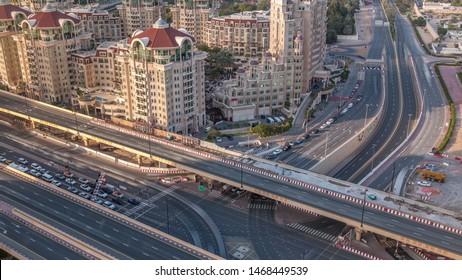 Aerial view of highway interchange in Dubai downtown evening timelapse. Al Saada street and Financial center road. Cityscapes traffic bridge, logistics. Roads and lanes Crossroads, Dubai, United Arab