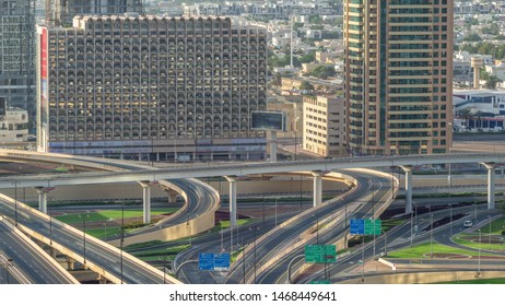 Aerial view of highway interchange in Dubai downtown timelapse. Cityscapes traffic bridge, logistics. Roads and lanes Crossroads, Dubai, United Arab Emirates