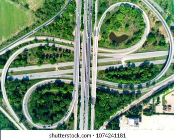 Aerial view of highway interchange overpass turn arounds and transportation