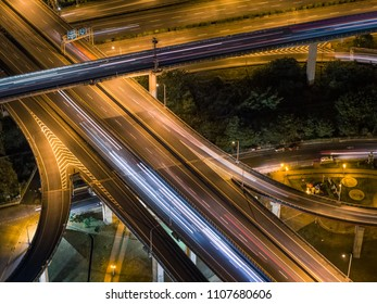 Aerial View of Highway Interchange - Transport concept image, birds eye view use the drone at night in Pingzhen Interchange System, Taoyuan, Taiwan.