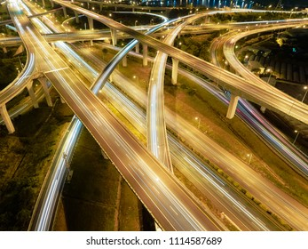 Aerial View of Highway Interchange - Transport concept image, long exposure birds eye view use the drone in Taoyuan International Airport System Interchange, Taoyuan, Taiwan.