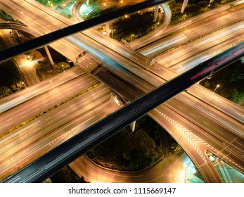 Aerial View of Highway Interchange - Transport concept image, long exposure birds eye view use the drone, shot in Pingzhen Interchange System, Taoyuan, Taiwan.
