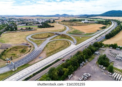 Aerial view of a highway intersection with a clover-leaf interchange Germany Koblenz