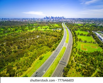 Aerial view of highway and Melbourne City skyline