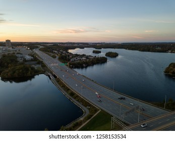 Aerial view of a Highway in the Modern City during a vibrant Sunset. Taken in Halifax, Dartmouth, Nova Scotia, Canada.