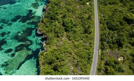 Aerial view of the highway near ocean in Wakatobi, Indonesia, Asia
