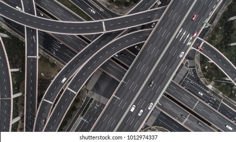 Aerial view of highway and overpass in city on a cloudy day - Shutterstock ID 1012974337