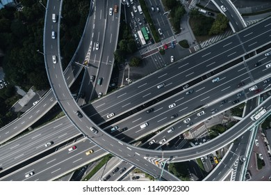 Aerial view of highway and overpass in city on sunny day