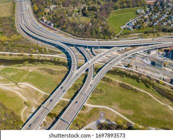 Aerial view of highway overpass with large multilane road bridge. Motorway in spring in Switzerland.