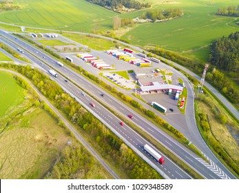 Aerial view of highway rest area with restaurant and large car park for cars and trucks. D5 motorway in west Bohemia, Czech republic, European union. Top view of highway infrastructure.