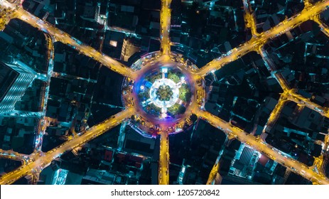 Aerial view highway road 6 way intersection roundabout or circle at dusk for transportation, distribution or traffic background.