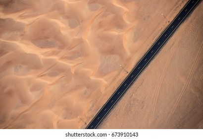 Aerial view of highway road in the desert