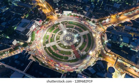 Aerial view highway road intersection roundabout or circle at night for transportation, distribution or traffic background.