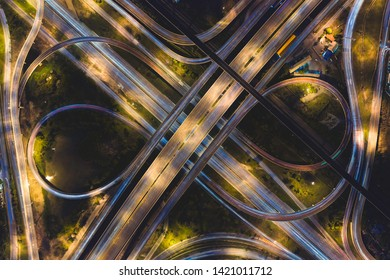 Aerial view of highway at rush hour at night time with car trail and traffic. view from drone