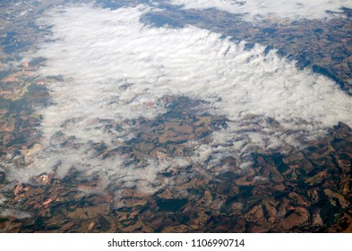 Aerial view to hills and clouds over them