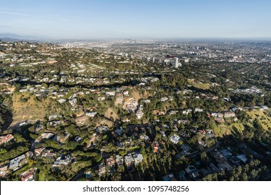 Aerial view of hillside and canyon homes above Beverly Hills and West Hollywood in Los Angeles California.