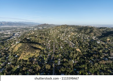 Aerial view of hillside homes along Laurel Canyon Blvd in the Studio City and Hollywood Hills area of the San Fernando Valley in Los Angeles California.