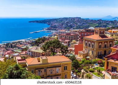 Aerial view from hilltop over Naples, Italy. View on Old Town of Naples from Castel Sant'Elmo. Sunny spring day.  Many colorful buildings and gulf of Naples. Houses built close to each other, closely.