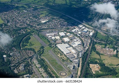 Aerial view of the historic Brooklands Racing Circuit, Weybridge, Surrey.  The former aerodrome and plane manufacturing base is now home to a transport museum, manufacturing and retail companies.