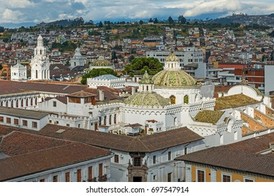Aerial view of the historic city center of Quito with the domes of the Company de Jesus in the foreground and the traditional colonial architecture, Ecuador.