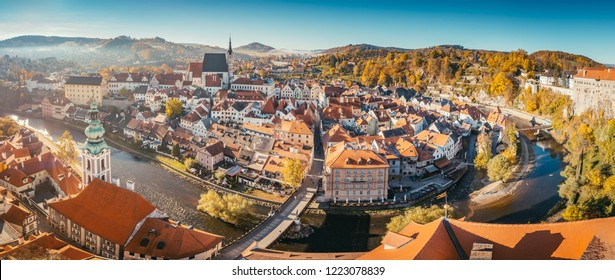 Aerial view of the historic city of Cesky Krumlov with famous Cesky Krumlov Castle, a UNESCO World Heritage Site since 1992, in beautiful golden morning light at sunrise in fall, Czech Republic
